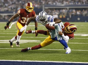 Oct 27, 2014; Arlington, TX, USA; Dallas Cowboys receiver Dez Bryant (88) reaches for the end zone for a second quarter touchdown against Washington Redskins safety Ryan Clark (25) and cornerback David Amerson (39) at AT&T Stadium. Mandatory Credit: Matthew Emmons-USA TODAY Sports